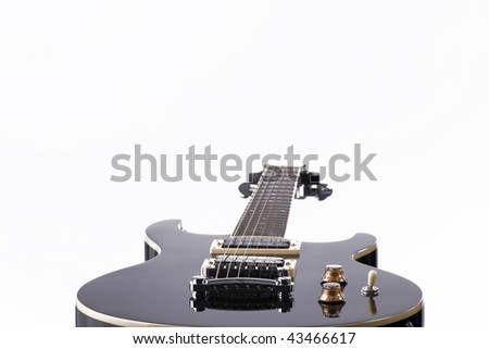 A piano black finish electric guitar isolated on a white background.
