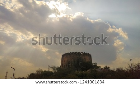 A pic of a fort with a beautiful sky scene