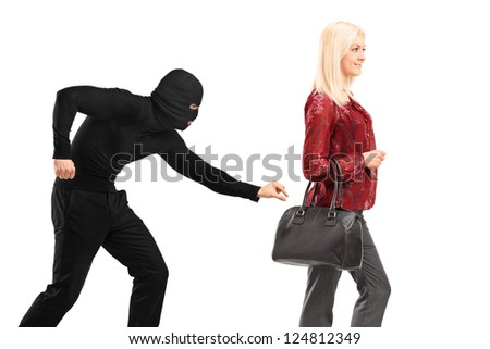 A pickpocket with mask trying to steal a from a woman carrying a purse isolated on white background