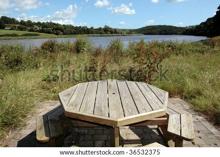 a picnic bench in knockanore county waterford in the south of ireland in summer on the blackwater river edge