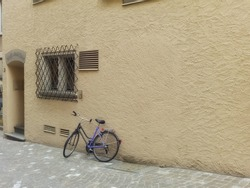 A Pictorial view of a cycle parked outside a house in Europe street
