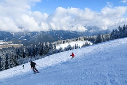A picture from the ski resort in the austrian Alps. Snow and weather are perfect, slopes are empty. Skiing is passion in these conditions. The mountains around are great visible.