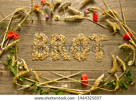 "A picture layed with cereals in form of a collar for Thanksgiving inside is the word ""Brrot"" (german language) designed. A decoration picture from the bird`s eye view."