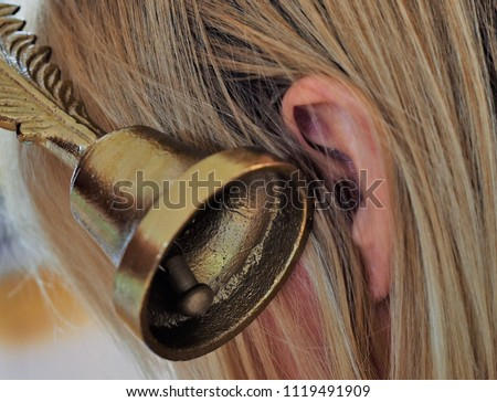 A picture of a bell next to an ear depicts tinnitus or known also ringing in the ear is a condition that many who have hearing loss or hearing damage suffer from