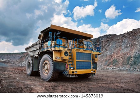 A picture of a big yellow mining truck at work site