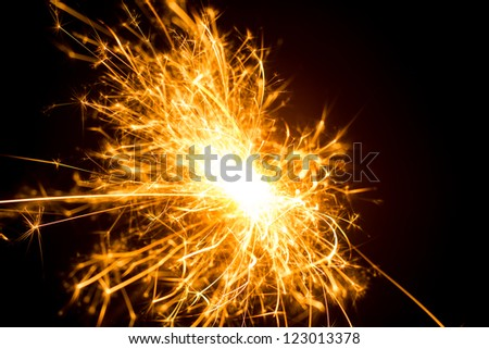a picture of a burning sparkler
