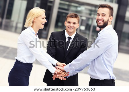 A picture of a business team outside modern building