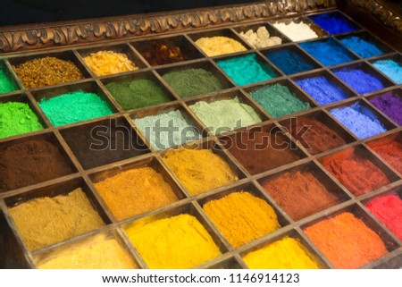 A picture of a colored sand inside the boxes. Many shades of different colors. The color is natural.  #1146914123