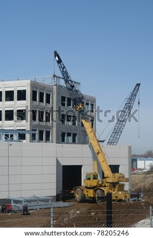 A picture of a cranes on a construction site