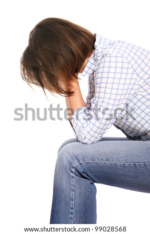 A picture of a frustrated woman covering her face over white background - stock photo