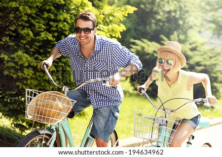 A picture of a happy couple spending free time on bikes in the city Stock fotó ©
