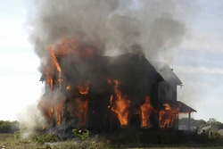 A picture of a house on fire before the firemen arrived