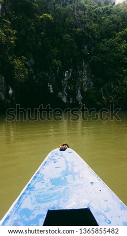 a picture of a kayak going in a cave in Puerto Princesa Underground River, Palawan, Philippines
