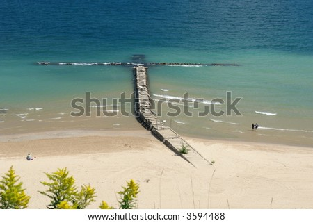A picture of a lake with boardwalk resembling cross