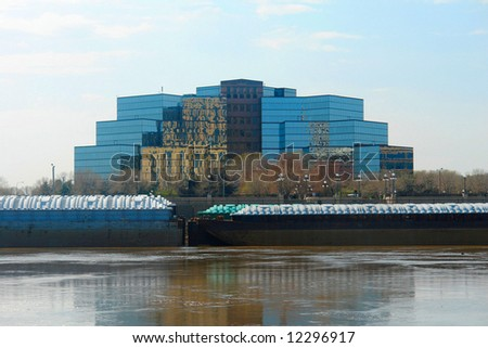A picture of a large glass building across Mississippi river.