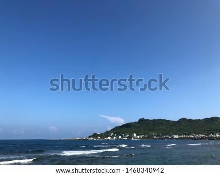A picture of a large picture of Okinawa's kite, sky and sea
