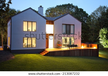 A picture of a modern luxury house and garden