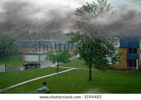 a picture of a powerful thunder storm in urban area