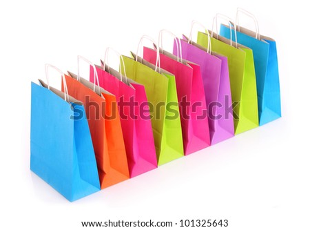 A picture of a row of colorful shopping bags over white background