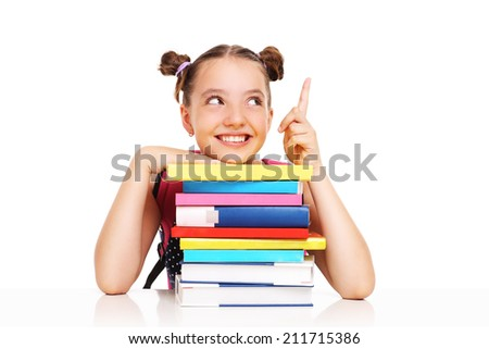 A picture of a schoolgirl with books pointing at something over white background