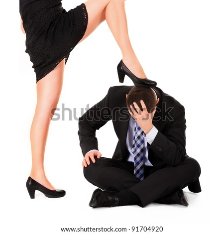 A picture of a sexy woman dominating a man over white background