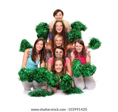 A picture of a team of young beautiful cheerleaders posing over white background