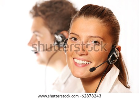 A picture of a team of young call center workers, pretty woman in the foreground