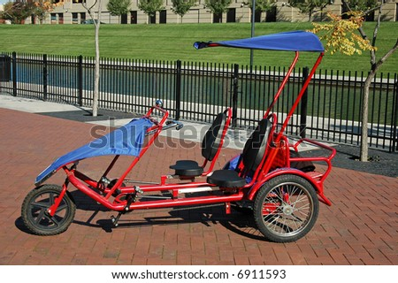 A picture of a tricycle for two along the canal in indianapolis