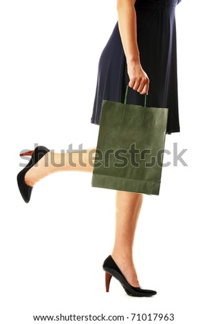 A picture of a woman in high heels with a shopping bag over white background