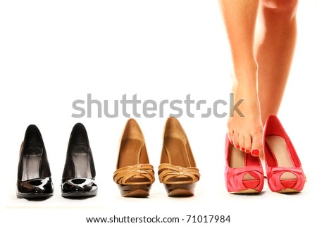 A picture of a woman putting on new shoes over white background
