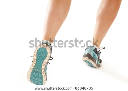 A picture of a woman's legs running on a white background..