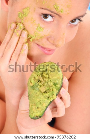 A picture of a young beautiful woman having stone massage in exotic spa center