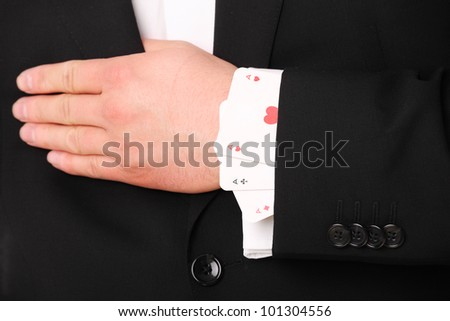 A picture of a young businessman hand holding three aces