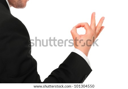 """A picture of a young businessman showing """"ok"""" sign over white background"""
