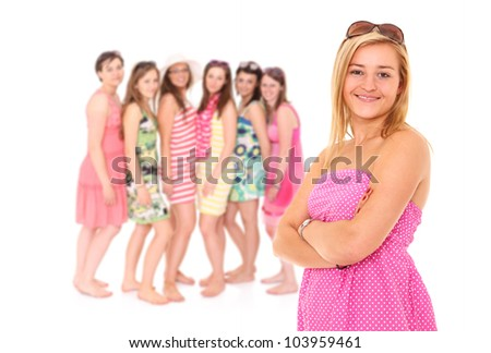 A picture of a young confident woman and a group of her girlfriends standing over white background