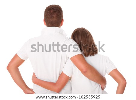 A picture of a young couple standing over white background