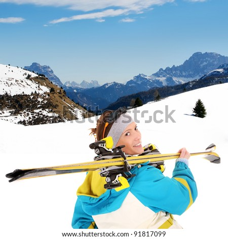 A picture of a young female skier enjoying snow in the Alps