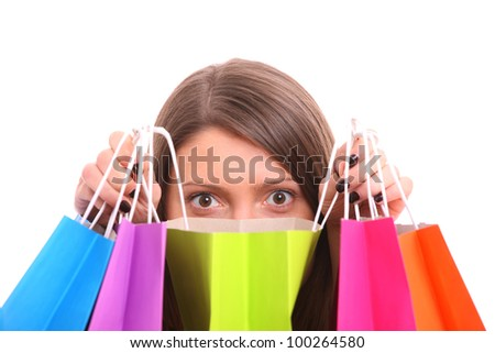 A picture of a young happy woman among shopping bags over white background