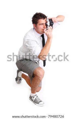 A picture of a young man in shorts trying to take a picture against white background