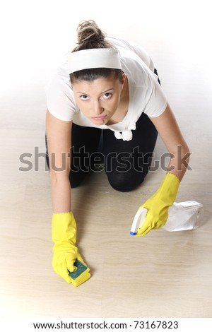 A picture of a young woman cleaning the floor over light background