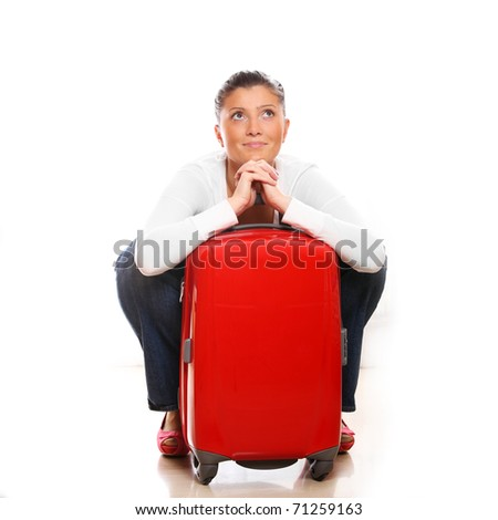 A picture of a young woman with a red suitcase ready to go on holidays