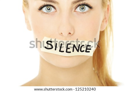 "A picture of a young woman with a tape on her mouth and a notice ""silence"""
