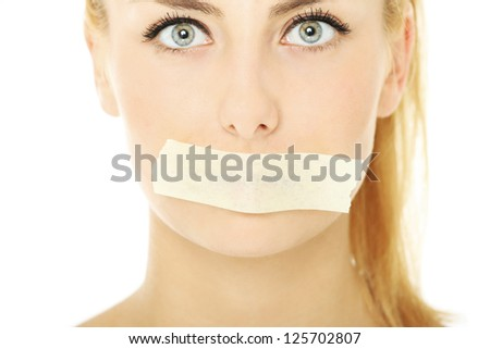 A picture of a young woman with a tape on her mouth over white background