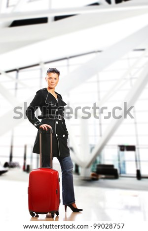 A picture of an elegant woman traveller waiting at the airport - stock photo