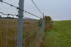 a picture of barbed wire fence