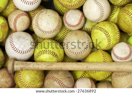 a picture of baseballs and softballs