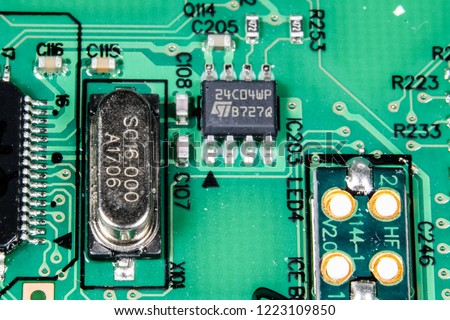 A picture of chip resistors, microchip, crystal oscillator and LED chip on a printed circuit board.