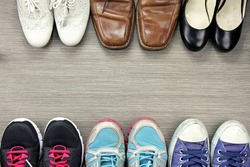 A picture of difference, Shot of several design of men and women shoes, The compare of leather and sport shoes.