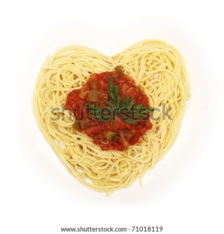 A picture of fresh spaghetti in the shape of a heart for Valentine's day