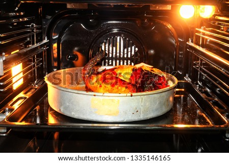 A picture of home made roasted chicken in the oven.